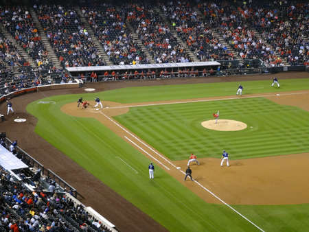 colorado rockies: DENVER - JULY 7: Angels pitcher Andrew Heaney throws pitch to batter with Rockies batter swinging at  incoming pitch with infield and ballpark in view and runner on first base on July 7, 2015 in Denver, Colorado.