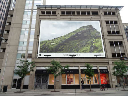 DENVER, COLORADO - JULY 7: Apple Iphone 6 camera ad on the side of building with Loft store on bottom floor in Denver, Colorado. Iphone is the most used camera in the world. July 7, 2015.
