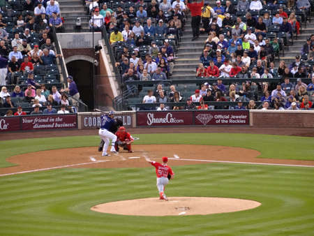 andrew: DENVER - JULY 7: Angels pitcher Andrew Heaney throws pitch to Rockies batter Carlos Gonzalez waiting on incoming pitch on July 7, 2015 in Denver, Colorado. Editorial