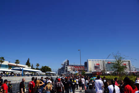 levis: SANTA CLARA - MARCH 29: People walking through parking lot to arena before the start of the showcase of the immortals, Wrestlemania 31, at the Levis Stadium in Santa Clara, California on March 29, 2015.