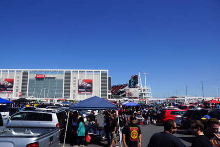 levis: SANTA CLARA - MARCH 29: People have fun tailgating parking lot before the start of the showcase of the immortals, Wrestlemania 31, at the Levis Stadium with posters on side of building in Santa Clara, California on March 29, 2015.