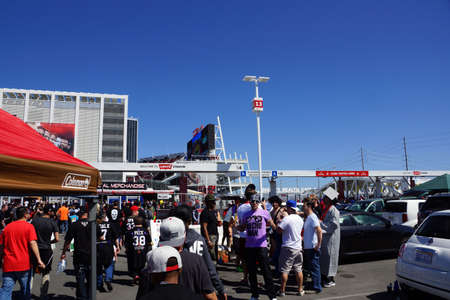 levis: SANTA CLARA - MARCH 29: Wrestling fans Cosplay have fun tailgating parking lot before the start of the showcase of the immortals, Wrestlemania 31, at the Levis Stadium with posters on side of building in Santa Clara, California on March 29, 2015. Editorial