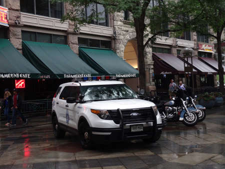 light duty: DENVER, COLORADO - JULY 7: Denver Police SUV and Motorcycles park on promenade to keep the peace in Denver, Colorado July 7, 2015. Editorial