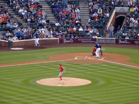 troy: DENVER - JULY 7: Angels pitcher Andrew Heaney throws pitch to Rockies batter Troy Tulowitzki waiting on incoming pitch on July 7, 2015 in Denver, Colorado.