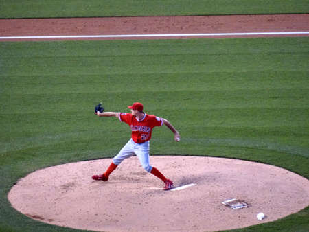 andrew: DENVER - JULY 7: Angels pitcher Andrew Heaney steps forward to throw pitch off mound on July 7, 2015 in Denver, Colorado.