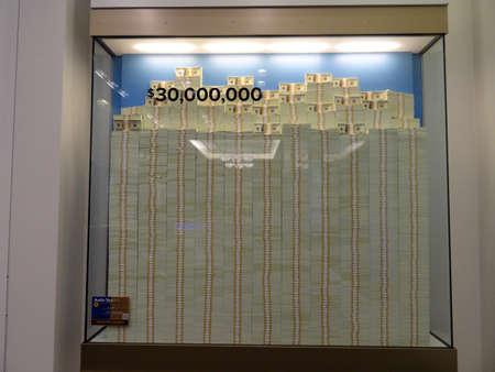 million dollars: DENVER, COLORADO - JULY 7: Stack of Hundred dollar bills in glass display case equally 30 million dollars inside United States Mint in Denver, Colorado.  July 7, 2015. Editorial