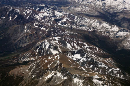sierra snow: Aerial view of Top of sierra nevada mountains during the summer with a small amount of snow still left on the mountains. Stock Photo
