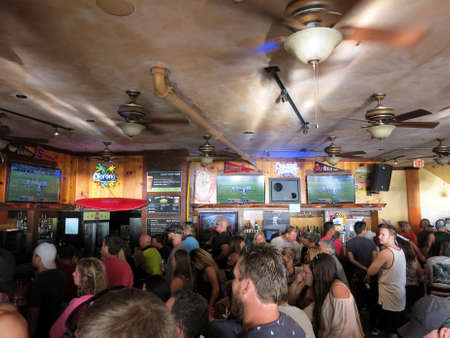 superbowl: WAIKIKI, OAHU - FEBRUARY 7:  Crowd People watch Superbowl 50 game at iconic Lulus Bar.  SupeBowl commercials cost roughly $4.5 million a piece taken February 7, 2016 Waikiki, Hawaii.