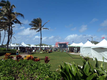 wanderlust: NORTH SHORE, OAHU - FEBRUARY 25: path leading to Wanderlust Oahu festival stage and booths against a blue sky and ocean on the North Shore of Oahu, Hawaii.  February 25, 2016. Editorial