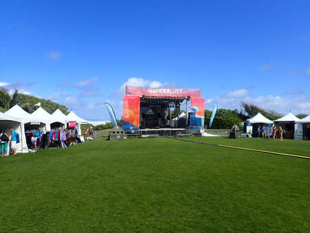 north shore: NORTH SHORE, OAHU - FEBRUARY 25: Wanderlust Oahu festival stage and booths against a blue sky and ocean on the North Shore of Oahu, Hawaii.  February 25, 2016.