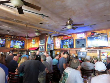 45 50: WAIKIKI, OAHU - FEBRUARY 7:  Crowd People watch Superbowl 50 game at iconic Lulus Bar.  SupeBowl commercials cost roughly $4.5 million a piece taken February 7, 2016 Waikiki, Hawaii.