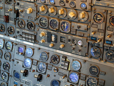 dials: Jet aircraft cockpit Equipment with various indicators, buttons, dials, and instruments.