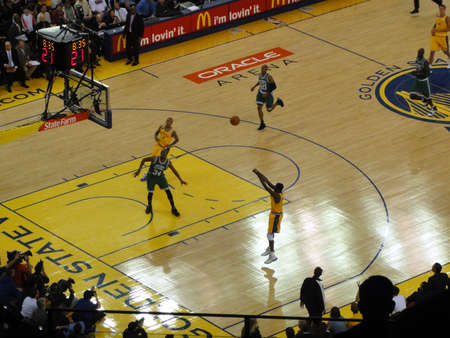 OAKLAND, CA - FEBRUARY 22: Celtics vs. Warriors: Warriors Dorell Wright take shoot with players going for rebound and ball flying in the air at Oracle Arena taken February 22, 2011 Oakland California.