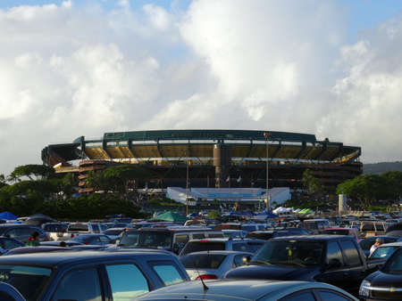 college football: HONOLULU - SEPTEMBER 19: Cars fill parking lot leading to Aloha Stadium before start of College football game on September 19, 2015.