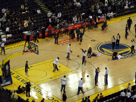 OAKLAND, CA - FEBRUARY 22: Celtics vs. Warriors: Golden State Warriors players take shoots during warm up session and reporters talking to cameras at Oracle Arena taken February 22, 2011 Oakland California. 報道画像