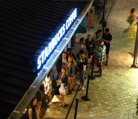 thursday: HONOLULU, HI - NOVEMBER 27: people wait in line for Caffeine at Starbucks Coffee on Grey Thursday evening at the Ala Moana shopping center. taken on November 27, 2014 at Ala Moana Shopping center in Honolulu, Hawaii. Editorial