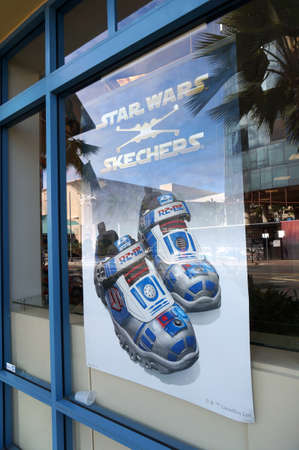 footware: HONOLULU - FEBRUARY 21, 2016: Skechers Star Wars shoe ad in the window of Famous Footware. Skechers is an American shoe company founded by CEO Robert Greenberg and his son Michael in 1992. Taken on February 21, 2016.