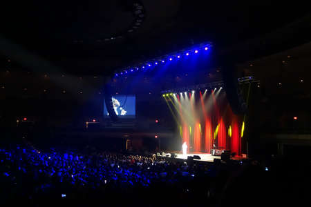 comedian: HONOLULU, HI - SEPTEMBER 27, 2014: Comedian Katt Williams on stage in front of large crown on stage at the Iconic concert hall the Neal Blaisdell Center Honolulu, Hawaii September 27, 2014.