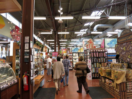 inspected: HONOLULU - DECEMBER 2: People explore Inside Kahala Whole Food Market filled with food and other consumer goods. Whole Foods is an American foods supermarket chain specializing in natural and organic foods.   Honolulu, Hawaii on December 2, 2015.