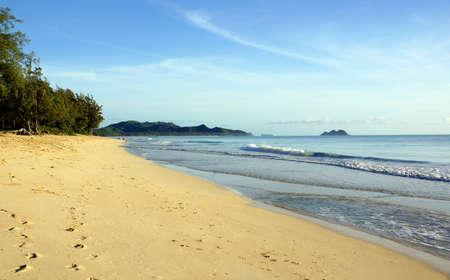 windward: Waves roll to shore on Waimanalo Beach looking towards mokulua islands on Oahu, Hawaii.  June 2014