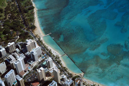aerail: Aerail view of Waikiki, Kapiolani Park, Swimming area, coral reef, Condos, Hotels of Honolulu and Ocean during the day.  Oahu, Hawaii April 2016. Stock Photo