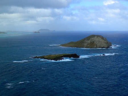 windward: Manana Island and Kaohikaipu Island are located on the Windward side of Oahu, north of Makapuu Point. The shape of the island actually resembles a rabbit the island both isalnds are seabird sanctuary. Stock Photo