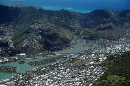 windward: Aerial view of Kuapa Pond, Hawaii Kai Town, Windward coast, clouds and Pacific Ocean on Oahu, Hawaii.
