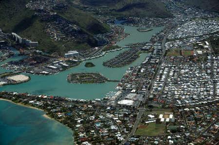 windward: Aerial view of Kuapa Pond, Hawaii Kai Town, Portlock, clouds and Pacific Ocean on Oahu, Hawaii. Stock Photo