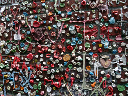 pike place market: SEATTLE- JUNE 24 : Close-up of The Market Theater Gum Wall in downtown Seattle on June 24, 2016. It is a local landmark in downtown Seattle, in Post Alley under Pike Place Market.