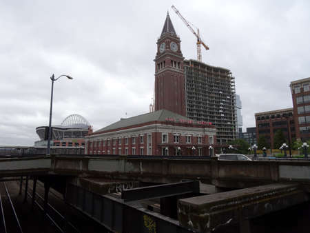 king street: SEATTLE - JUNE 24:  Seattle King Street Station a granite and brick train station built in 1906, Century Link Field and construction during summer on June 24, 2016 in Seattle Washington.