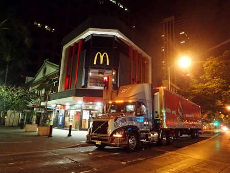 mcdonalds: HONOLULU - JANUARY 8: Truck Delivers food to McDonalds Store in Downtown Honolulu, Hawaii at Night McDonalds primarily sells hamburgers, cheeseburgers, chicken, french fries, breakfast items, soft drinks, milkshakes, desserts.  on January 8, 2016, Honolu