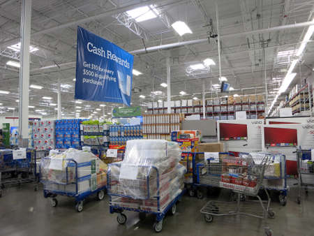 walmart: HONOLULU - JANUARY 4, 2016: Sams Club interior with pick up orders ready for pick up and products. Sams Club is an American chain of membership-only retail warehouse clubs owned and operated by Walmart.
