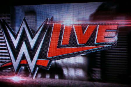 punch press: HONOLULU - JUNE 29, 2016: WWE Live logo on screen at WWE event at the Neal S. Blaisdell Center, Honolulu on June 29, 2016 Honolulu, Hawaii.