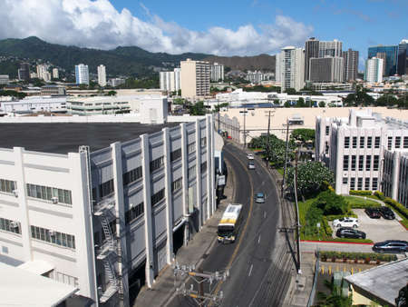 HONOLULU, HI - JULY 12, 2016: Aerial view of street with Bus, Iwilei buildings, cityscape on island of Oahu in the state of Hawaii.   July 12, 2016 Honolulu, Hawaii.