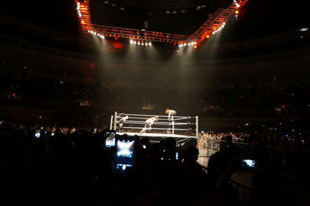 punch press: HONOLULU - JUNE 29, 2016: Crowd uses cellphones to record action in Ring of Dolph Ziggler and Baron Corbin wrestling at WWE Live event at the Neal S. Blaisdell Center, Honolulu. Editorial