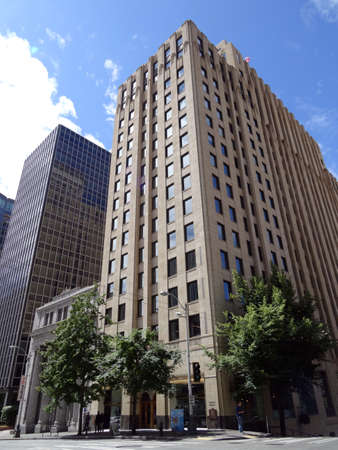 house exchange: SEATTLE - JUNE 24:  The Exchange Building, a 22-story Art Deco office building, located in the central business district of Seattle, Washington. It was designed to house the Seattle Stock Exchange by John Graham & Associates and completed in 1930.   Taken
