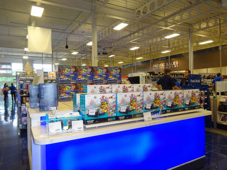 wii: HONOLULU - DECEMBER 15: Inside Best Buy store during holiday season with display of Nintendo Wii U and other electronics. Best Buy is an electronics retailer accounting for 19% of the U.S. market. December 15, 2014, Honolulu, Hawaii. Editorial