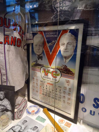 outfield: SEATTLE - JUNE 26: Framed Victorys Champion Poster featuring Franklin D. Roosevelt and Winston Churchill with Jerseys and other memorabilia at Mariners Hall of Fame at Safeco Field during baseball game, Seattle in June 26, 2016.