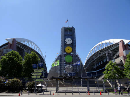 seahawks: SEATTLE - JUNE 26: USA Flag flies above CenturyLink, and Gate fence in Seattle in June 26, 2016. Home of the Seattle Seahawks (NFL), and Sounders (MLS). Editorial