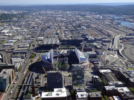 seahawks: SEATTLE - JUNE 24: Aerial view of CenturyLink, train tracks, buildings, roads, Safeco Field, and surrounding area in Seattle in June 24, 2016.