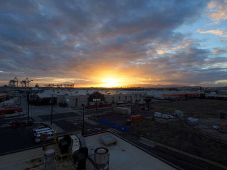 building a chain: HONOLULU - APRIL 10: Aerial view of Sunset over Lowes, Home Depot and Shipping Cranes with Matson Shipping containers around building on Oahu, Hawaii April 10, 2016.  Lowes Companies, Inc. is an American company that operates a chain of retail home impr Editorial