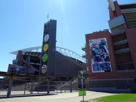 seahawks: SEATTLE - JUNE 26: USA Flag flies above CenturyLink, and Closed gate in Seattle in June 26, 2016. Home of the Seattle Seahawks (NFL), and Sounders (MLS).