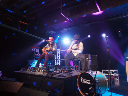 keith: HONOLULU, HI - JUNE 15: Tavana and Keith Batlin play guitar on stage at Crossroads in Hawaiian Brians on June 15 2016, Honolulu, Hawaii. Editorial