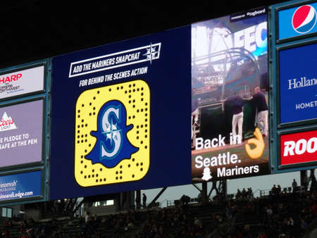 seahawks: SEATTLE - JUNE 24: Snapchat ad on screen in bleachers at Safeco Field during baseball game, Seattle in June 24, 2016. Home of the Seattle Mariners (MLB). Editorial