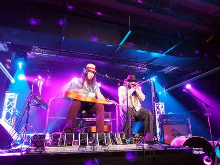 keith: HONOLULU, HI - JUNE 15: Tavana and Keith Batlin play guitar, harmonica, and sing on stage at Crossroads in Hawaiian Brians on June 15 2016, Honolulu, Hawaii. Editorial