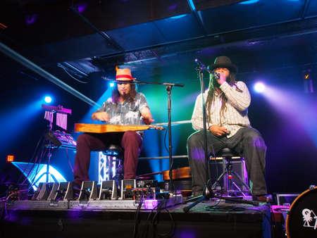 keith: HONOLULU, HI - JUNE 15: Tavana and Keith Batlin play guitar and sing on stage at Crossroads in Hawaiian Brians on June 15 2016, Honolulu, Hawaii.