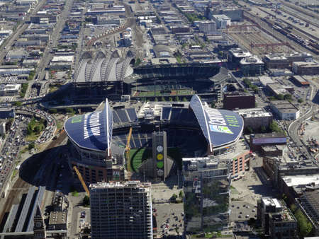 seahawks: SEATTLE - JUNE 24: Aerial view of CenturyLink, train tracks, buildings, roads and Safeco Field in Seattle in June 24, 2016. Home of the Seattle Seahawks (NFL), Mariners (MLB) and Sounders (MLS). Editorial