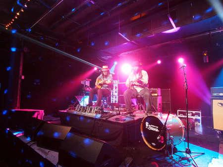 HONOLULU, HI - JUNE 15: Tavana and Keith Batlin play guitar and sing on stage at Crossroads in Hawaiian Brians on June 15 2016, Honolulu, Hawaii.