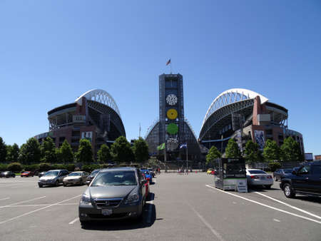 seahawks: SEATTLE - JUNE 26: USA Flag flies above CenturyLink, and parking lot in Seattle in June 26, 2016. Home of the Seattle Seahawks (NFL), and Sounders (MLS).