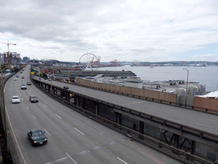 replaced: SEATTLE, USA - JUNE 25, 2016: Cars drive along State Route 99 runs along the Seattle seaboard as a double-decked highway system known as the Alaskan Way Viaduct which is scheduled to be replaced with a tunnel. Editorial